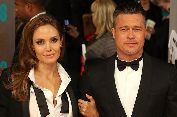 Анджеліна Джолі і Бред Пітт на церемонію BAFTA-2014 однаково вдяглися: зіркове подружжя обрали класичний костюм.